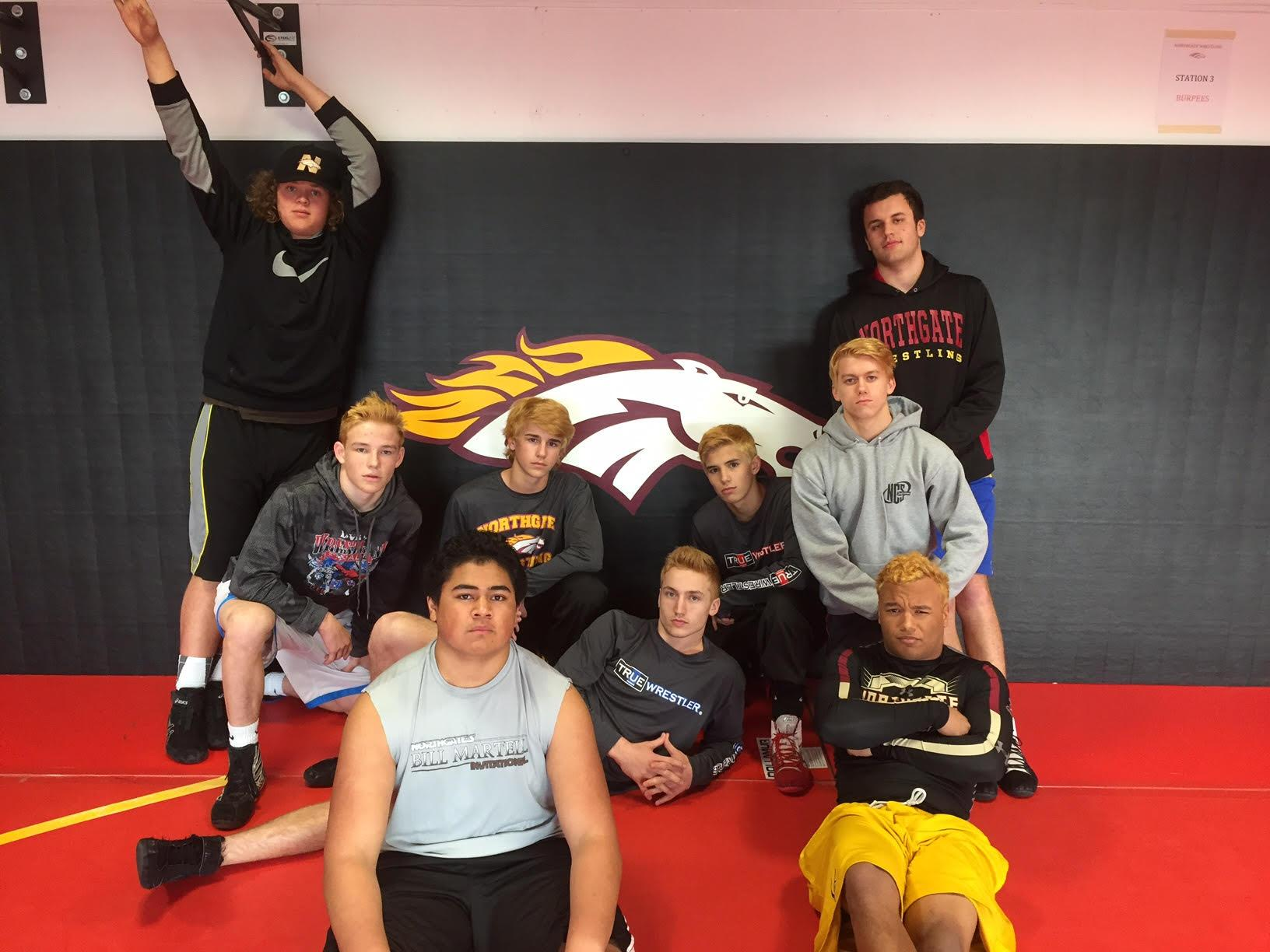 NCS participants Skylar Morford, Cormick Hamilton, David Ma'aki, Gage Mettler, Jaxon Pandelis, Cole Sanchez, Grant Chachere, Nathan Sutton, and Greg Ayala sport their bleached locks during practice.