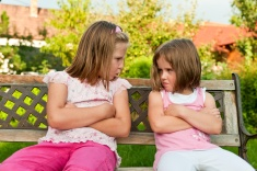 stock-photo-14274147-quarrel-offended-sisters