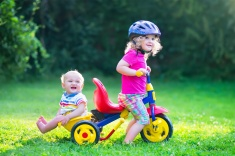 stock-photo-47921332-two-kids-on-a-bike-in-the-garden
