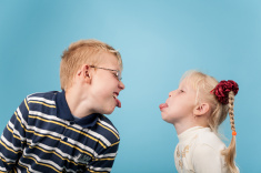 stock-photo-48841938-teenage-boy-and-girl-stick-out-tongues-to-each-other