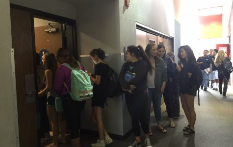 Girls wait in line to use the bathroom during brunch in early September. Some students say the tardy policy is impacting their use of the restrooms.