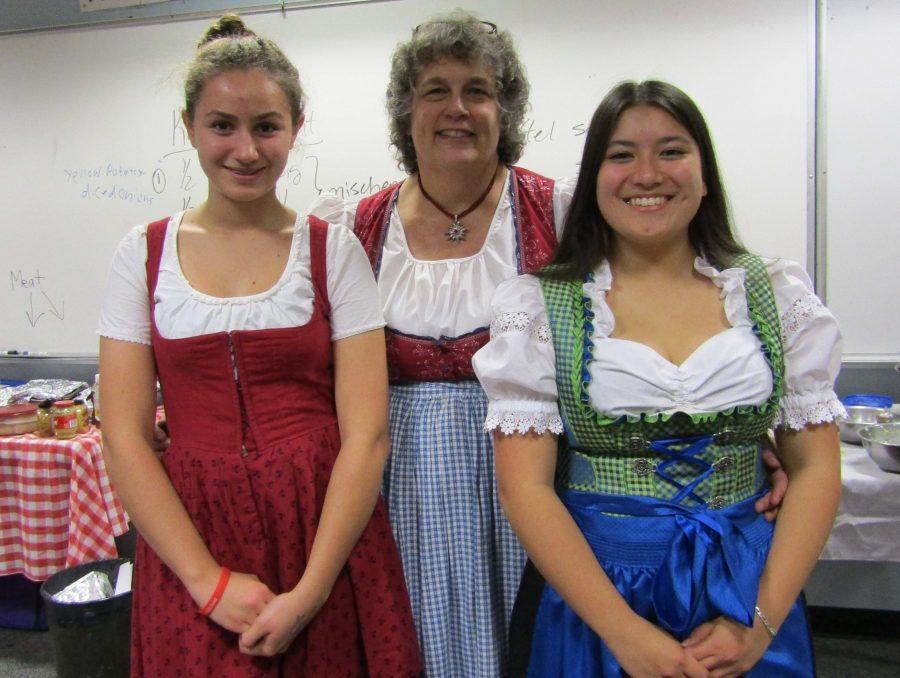 Clemence Poter-Coirre, German teacher Frau Nancy Grabow, and senior Claire Mizutani dress up to celebrate Oktoberfest on Nov. 4.