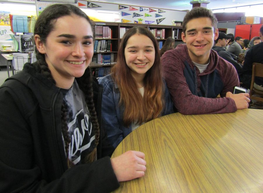 Triplets+Gianna%2C+Desiree%2C+and+Dante+Maurino+%28from+left+to+right%29+hang+out+together+in+the+library+at+lunch.+