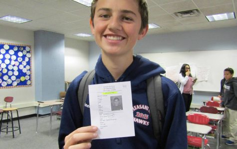 Freshman Anthony Giannini receives a pass with photo to leave his English class in February