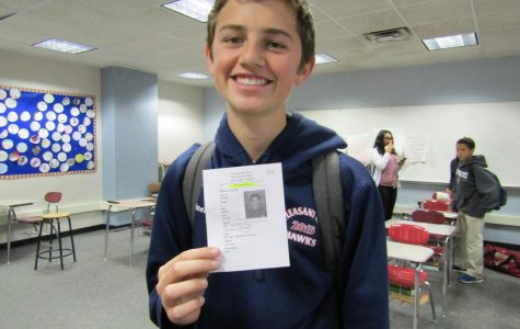 Freshman Anthony Giannini poses with his picture on his tardy note.
