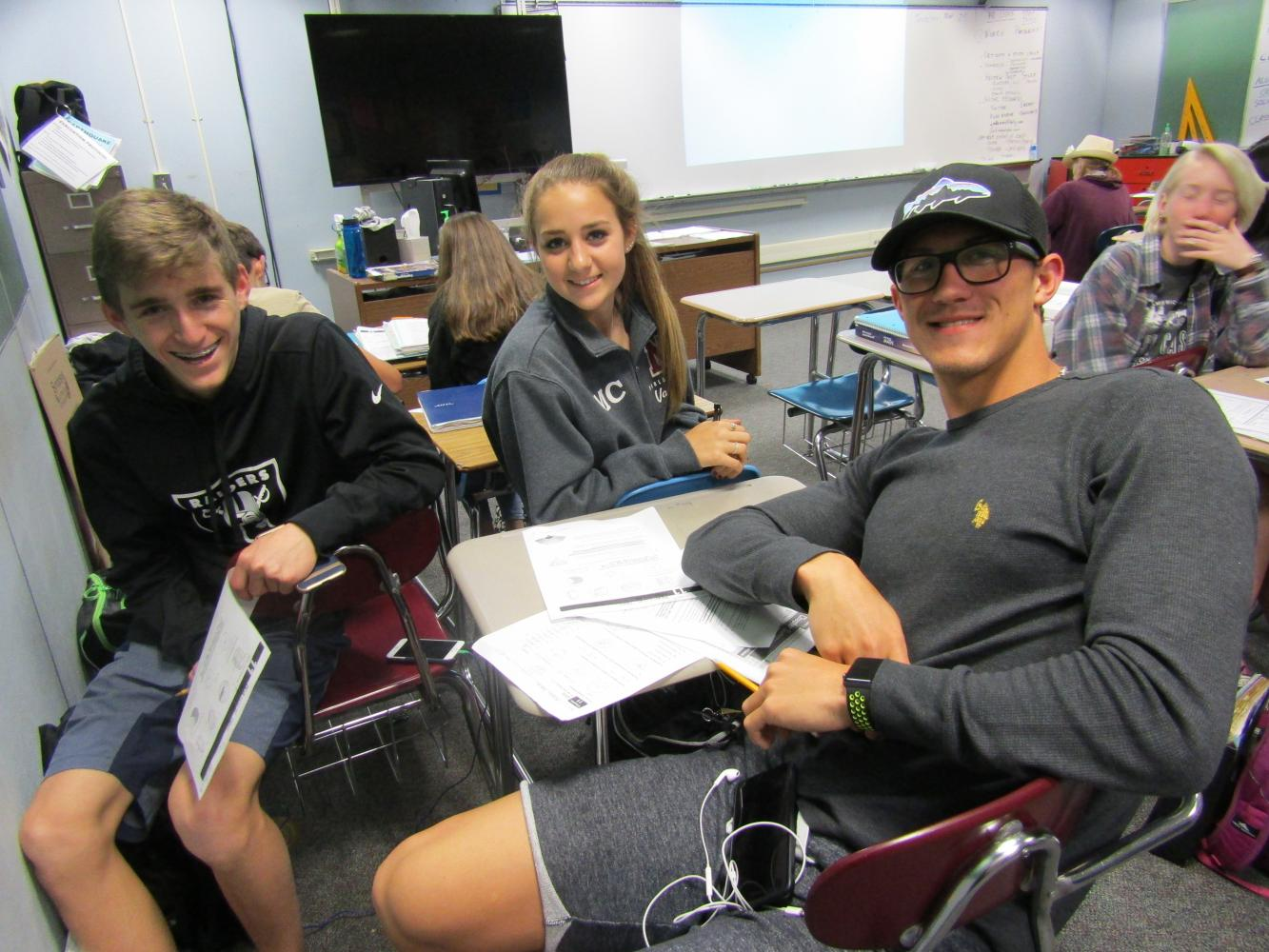 Sophomores Ryan Crostwaite and Maddie Chappell study in math on May 25 with junior Alexei Sancov, an Olympian who set several records.