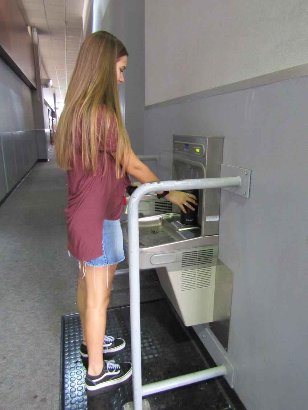 Junior Emma Meril tests out the new hydration stations.