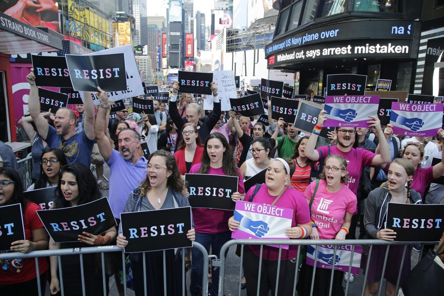 Demonstrators gather at Times Square in New York City to protest the ban issued by President Trump on July 26 that bars transgender soldiers from serving in the Armed Forces
