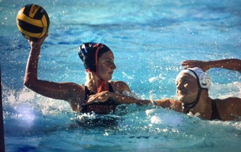Varsity water polo player Naomi Jenkins looks to score against an Amador Valley defender in  September.