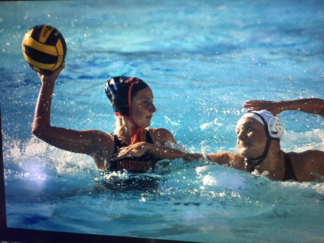 Varsity+water+polo+player+Naomi+Jenkins+looks+to+score+against+an+Amador+Valley+defender+in++September.