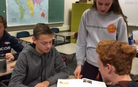 Maddy Gossett, a junior and mentor, looks on as freshmen James Park, left, and Jackson Cooper work in their Link Crew class during Study Session Dec. 18.