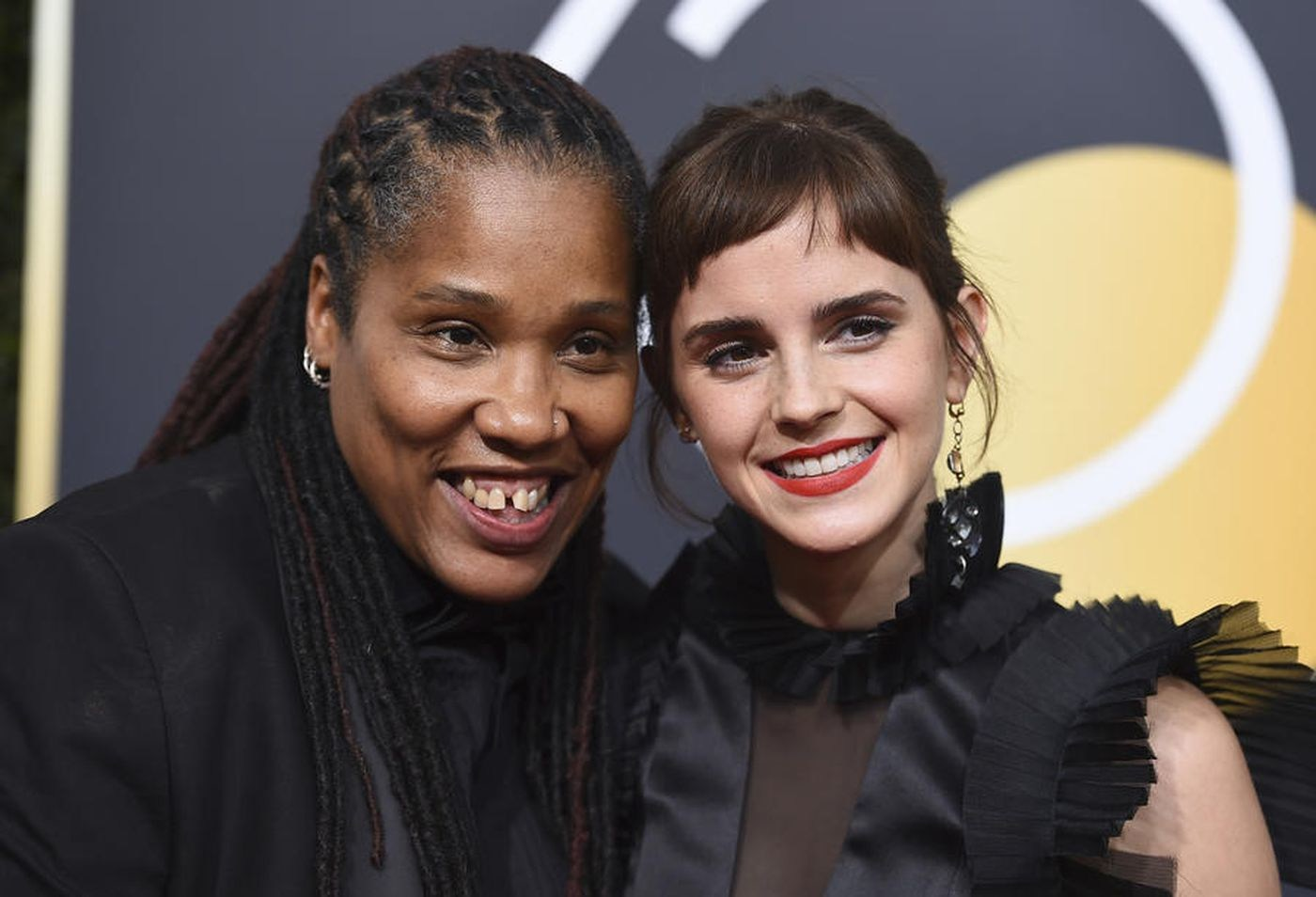 British feminist Marai Larasi (left) with Emma Waston wear black in support of the Time's Up movement at the 2017 Golden Globe Awards.