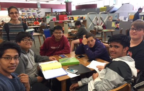 Hanging out in the library: Freshmen Harsheeth Aggarwal, Paul Valencia, sophomore Priya Raman, and freshmen Dillon Fletcher, Aaron Carlton, Drew Fox, and Oman Omar have a study session in the library after school on May 15.