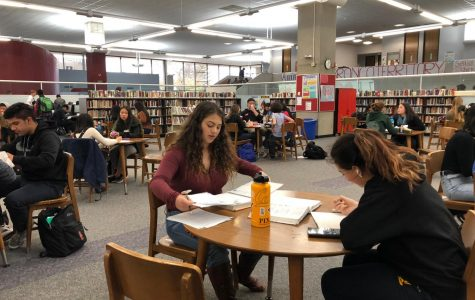 Students prepare for finals during lunch in the crowded library. 12/4/18
