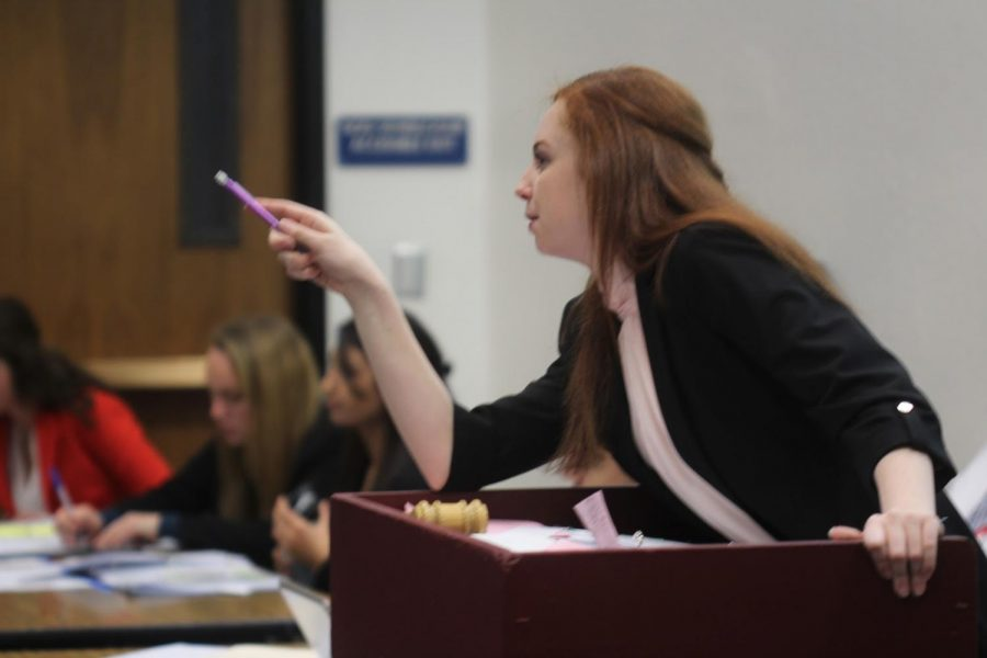Caitlin Reimer, the President Pro Tem of one of Northgate's five student senates, calls on a speaker during during the annual December Mock Congress.