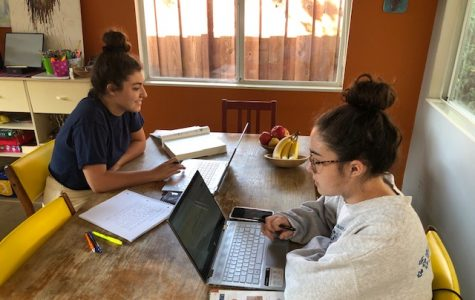 Seniors Zoe Moss, left, and her sister, Camille, participate in their sociology class first period Monday Oct. 5.  Zoe Moss said she's disappointed to not be in school but