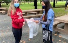 Megan Briggs and Cady Chan, sophomore members of the Plastic Pollution Cleanup Club, help the environment at an Oct. 24 cleanup at Concord Community Park.