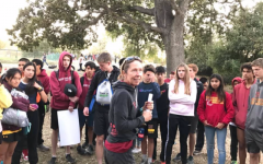 Coach Ruth Seabrook (center) gives advice to her runners during the 2019 season before they begin their training.