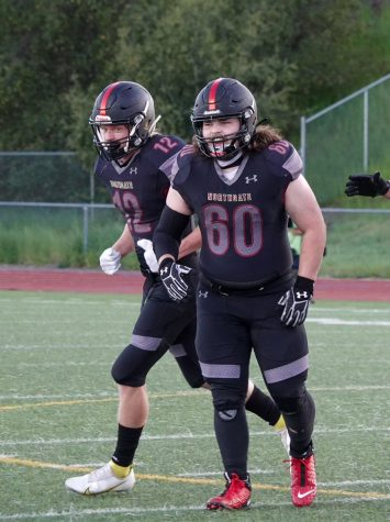 Seniors Andrew Daigle, left, and Cooper Champion are two of the varsity Broncos who will be on the field April 2 for the first home football game. Junior varsity plays at 4:40 p.m. and varsity kicks off at 7 p.m.