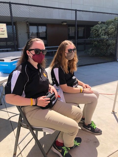 Seniors Jamie Champion, left, and Amanda Dahlgren attend water polo games April 17 as members of their Sports Medicine program where students trainers are assigned to each school athletic team in case of injury or medical need.