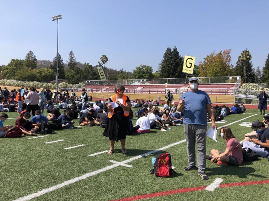 Nothing says school is in session quite like a fire drill, which occurred Aug. 24. German teacher Nancy Grabow and biology teacher Paul Gundelfinger monitor their students as more than 1,600 students and staff converge on the sports stadium to rehearse the drill at the end of second period.